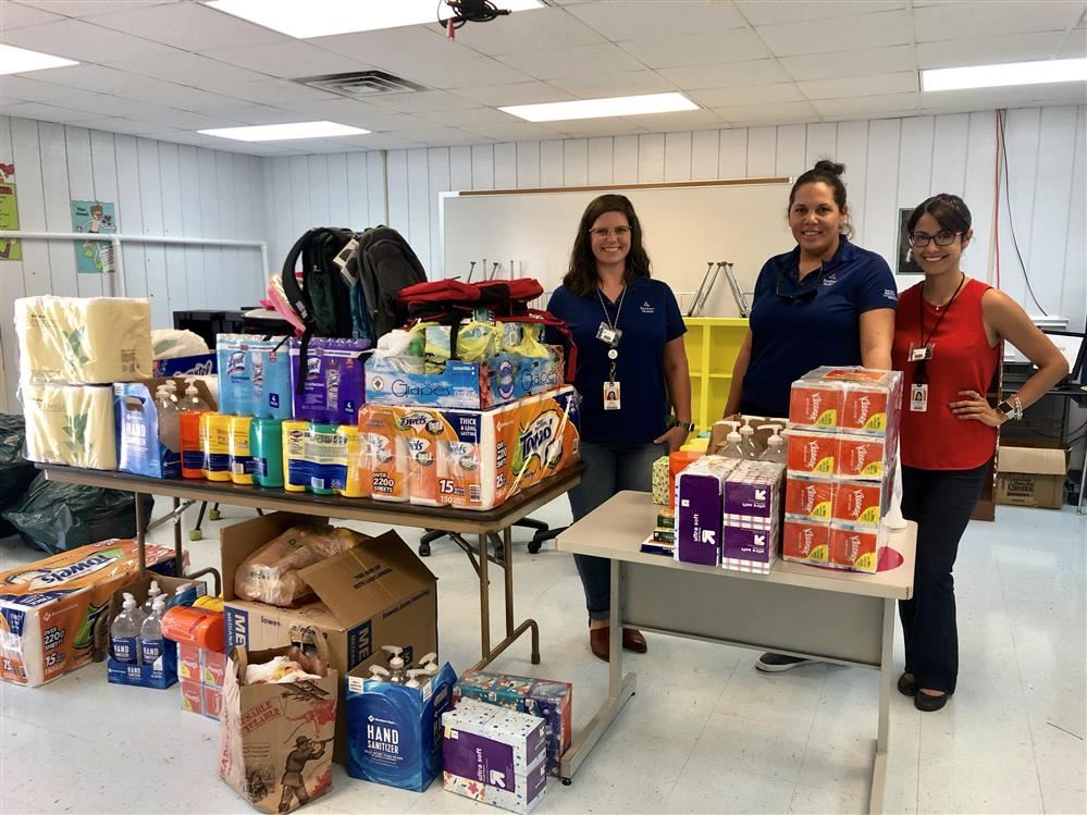 Employees of Southern Company/Alabama Power pictured with donations to our school.